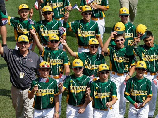 The team from Johnston, Iowa, participates in the opening ceremony of the 2016 Little League World Series tournament in South Williamsport, Pa., on Thursday, Aug. 18, 2016.