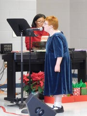 Katy McBride performs a solo portion of White Christmas.