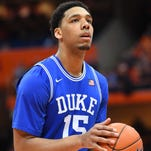 Duke Blue Devils center Jahlil Okafor prepares to shoot a free throw against the Syracuse Orange during the second half at the Carrier Dome.  Duke defeated Syracuse 80-72.