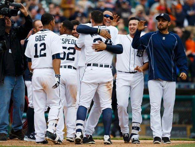 May 21: Tigers catcher James McCann is congratulated