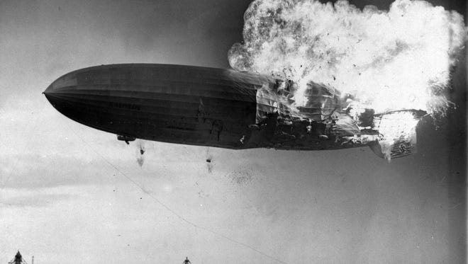 The German zeppelin Hindenburg bursts into flames as it noses toward the mooring post at the Naval Air Station in Lakehurst, N.J. on May 6, 1937.  Thirty-five people on board and one ground crew member were killed.   (AP Photo/Murray Becker)