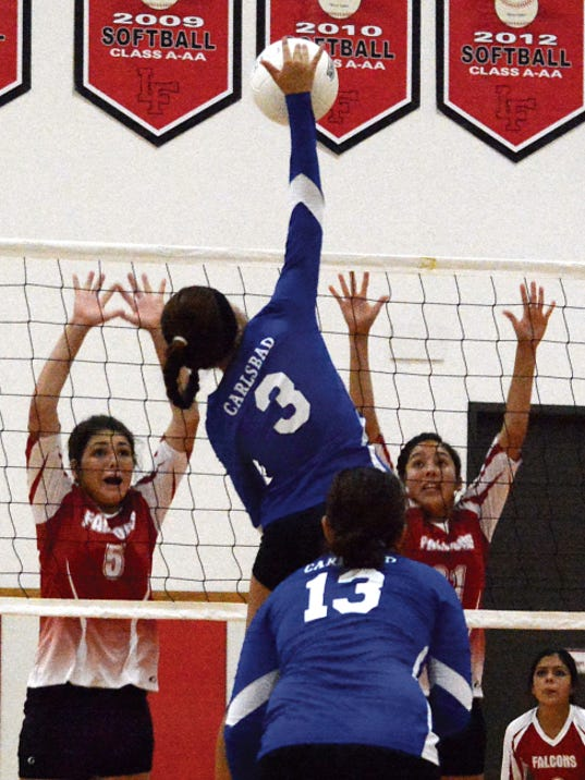 Matt Hollinshead — Current-Argus Loving senior middle blocker Ashlen Sartin (5) and junior outside hitter Briana Rodriguez (21) attempt to block a Carlsbad JV kill attempt late in the first set Thursday.
