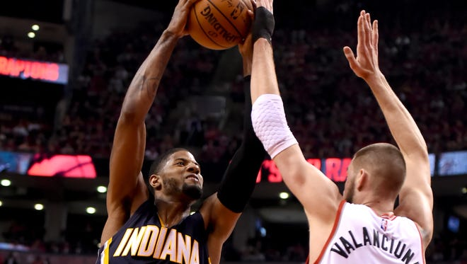 Indiana Pacers forward Paul George (13) shoots against Toronto Raptors center Jonas Valanciunas  in Game 7 of their first-round series Sunday night, May 1, 2016, at Air Canada Centre.