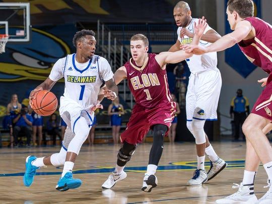 Delaware's Kory Holden drives to the basket while Elon's Luke Eddy defends.