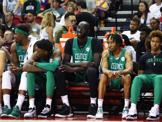 Jul 6, 2019; Las Vegas, NV, USA; Boston Celtics center Tacko Fall (center) sits on the bench with teammates against the Philadelphia 76ers during an NBA Summer League game at Thomas & Mack Center. Mandatory Credit: Mark J. Rebilas-USA TODAY Sports