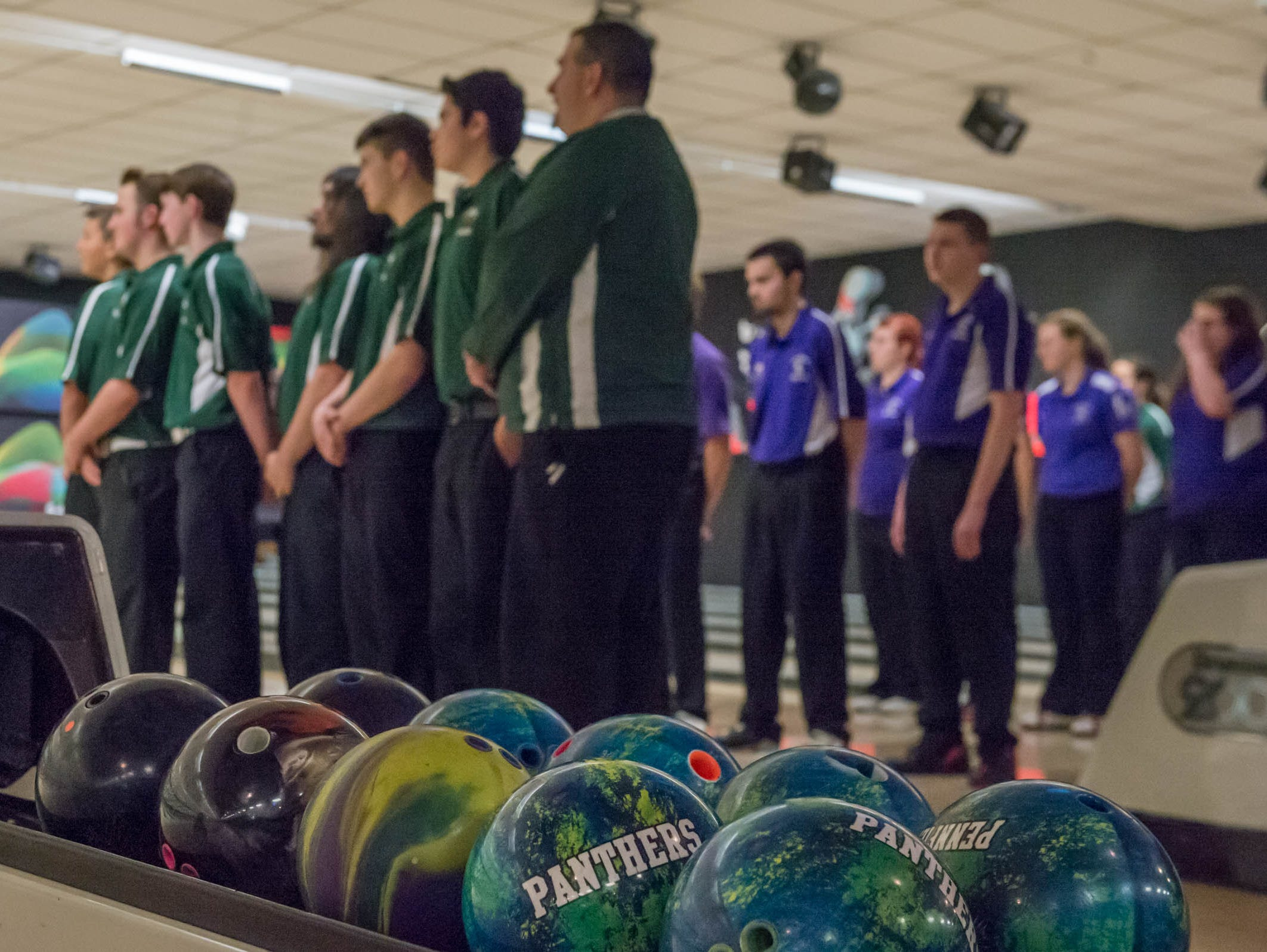 Highs school bowlers from Pennfield and Lakeview line up during national anthem at Nottke's Bowling on Thursday.
