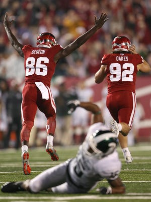 Griffin Oakes (92) and Joseph Gedeon (86) celebrate after Oakes' game-winning field goal in overtime vs. Michigan State.