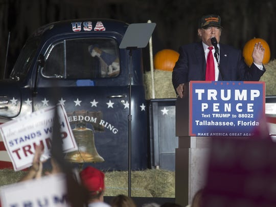 GOP presidential nominee Donald Trump speaks during his first campaign stop in the capital city at the Tallahassee Automobile Museum.
