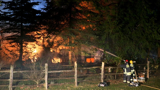 South Kitsap Fire and Rescue fights a fire early Wednesday in a rural setting on Woods Road in South Kitsap.
