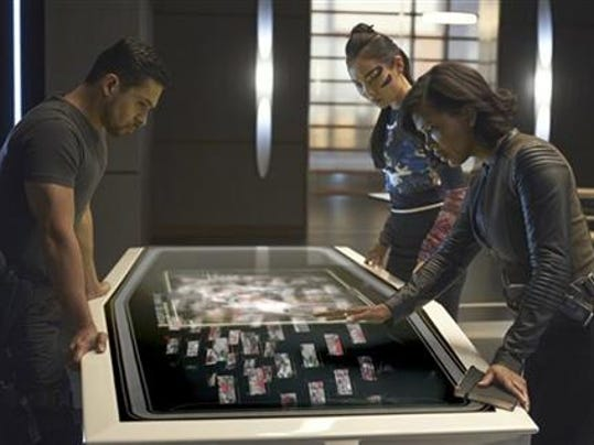 "In this image released by Fox, Wilmer Valderrama, from left, Li Jun LI and Meagan Good appear in a scene from ""Minority Report,"" premiering Monday, Sept. 21 at 9:00 EDT on Fox."
