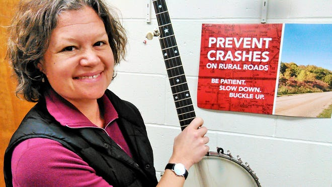 Brandi Janssen of Iowa City promotes Iowa farm safety by day and old time rural music after hours.