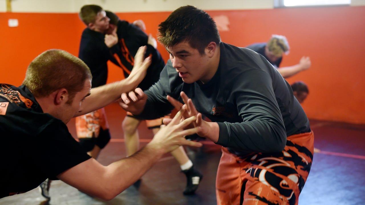 Spring Grove's Nathan Young wrestles Susquehannock's