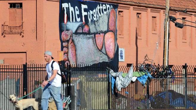 """Seen with a long lens from Pajaro St. and E. Market in Salinas, """"The Forgotten"""" is at least thirty feet long and was installed by art group C3 using a scissor jack."""