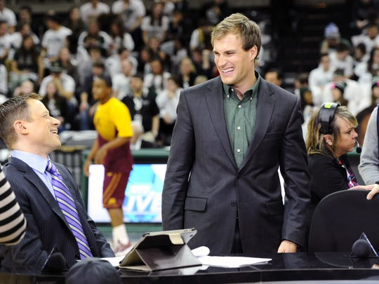 The Big Ten Network's  Dave Revsine, left, jokes with former MSU quarterback Kirk Cousins as the Big Ten Network records on the court before MSU takes on Minnesota at the Breslin Center in Thursday in East Lansing.
