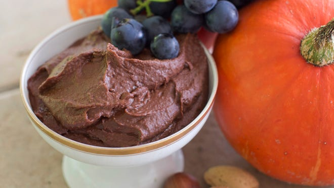 Chocolate hummus in Concord, N.H. on Sept.  29, 2014. The hummus is rich, creamy and chocolatey, and thick enough to spread easily. Think of it as a slightly more textured Nutella, and every bit as sweet and delicious. (AP Photo/Matthew Mead)