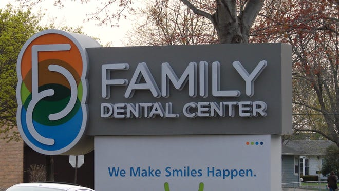 Family Dental Center has a new sign as part of its updated image.