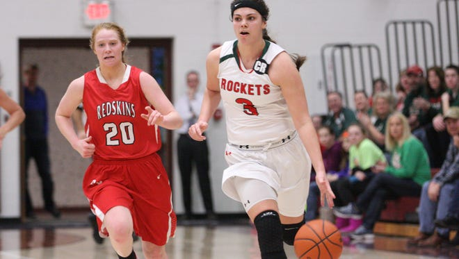 Oak Harbor's Andrea Cecil handles the ball Saturday as Port Clinton's Marissa Day chases the play.