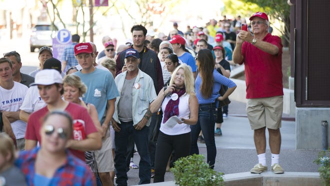 People wait in line before Republican presidential candidate Donald Trump speaks at the Phoenix Convention Center on Aug. 31, 2016. The line wrapped several blocks around the Phoenix Convention Center.