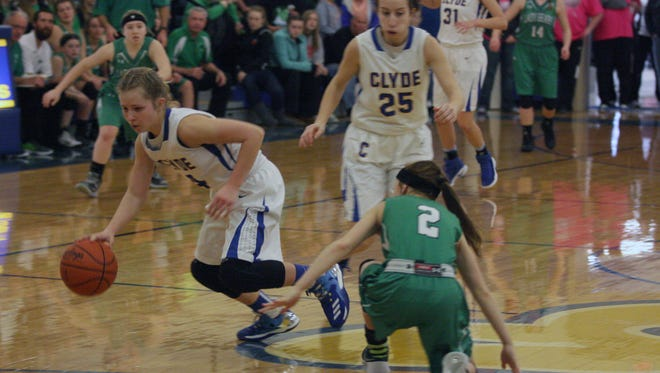 Clyde's Heidi Marshall takes off with one of three steals late in Saturday's victory.