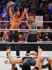 WWE's Seth Rollins beats Dean Ambrose during a match in Moline, Ill., on April 28, 2015. Rollins is a Davenport native.