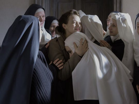 "Mathilde (Lou de Laâge) aids a group of nuns at a Polish abbey in ""The Innocents."""