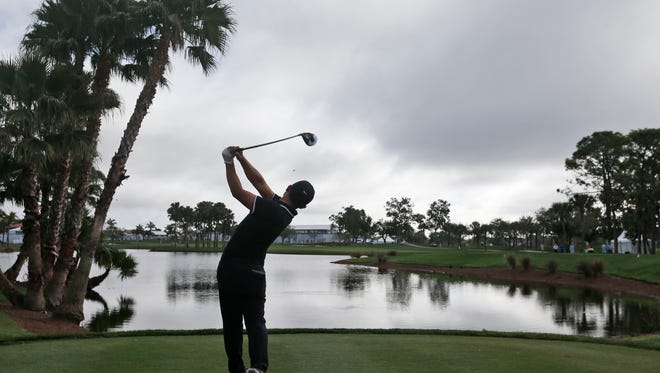 C.T. Pan, of Taiwan, tees off on the ninth tee during the second round of the Honda Classic golf tournament, Friday, Feb. 24, 2017, in Palm Beach Gardens, Fla.