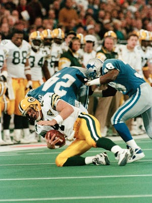 The Lions sack Brett Favre during their 30-20 win over the Packers at the Silverdome on Jan. 2, 1994. The Lions intercepted Favre four times and won the NFC Central Division title.