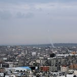 Rockets fired by Palestinian militants from Gaza toward Israel trail smoke above Gaza City on Wednesday. The terrorist group Islamic Jihad in Gaza fired 60 rockets toward Israel on Wednesday and Thursday.