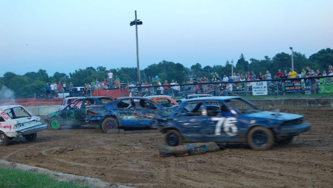 Smashing cars again and again always draws a huge crowd at the Boone County Fair.