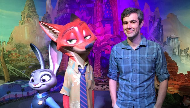 """Justin Weber stands with """"Zootopia"""" characters Judy Hopps, left, and Nick Wilde."""