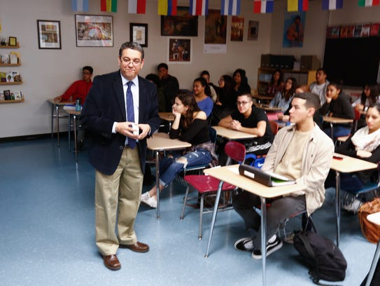 Spanish teacher Francisco Garcia-Quezada, left leads
