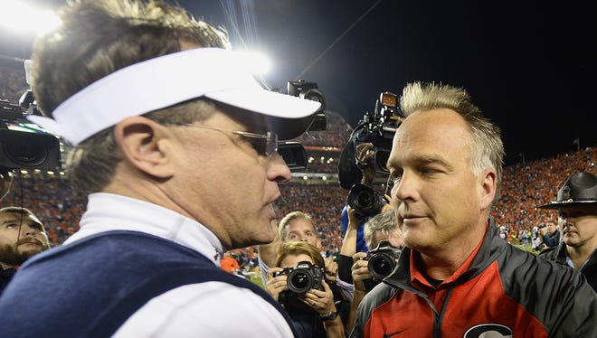 Auburn coach Gus Malzahn shakes hands with Georgia coach Mark Richt after the 2013 game between the rivals.