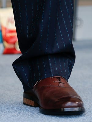 """Former Seattle Mariners and Cincinnati Reds player, Ken Griffey Jr., wore a suit with pinstripes that read """"Hall of Fame Class of 2016"""" and shoes with soles made of a game-used bat during the induction ceremony into the National Baseball Hall of Fame, Sunday, July 24, 2016, at the Clarks Sports Center in Cooperstown, N.Y."""