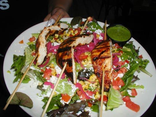Grilled chicken kabob salad dressed with cilantro-serrano