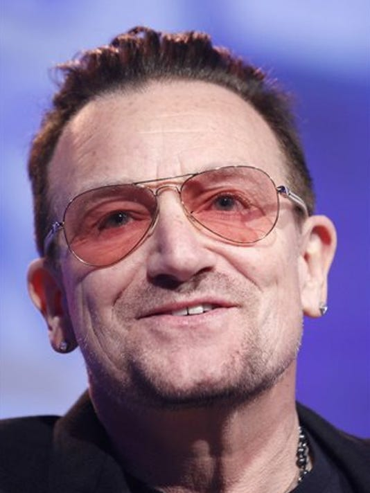 635518276879025395-Bono-hurts-arm