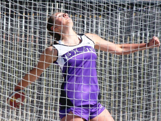 Yerington junior Kassidy Lommori, here throwing at the 2014 Yerington Relays, has one of the longer discus throws in the state this young season.