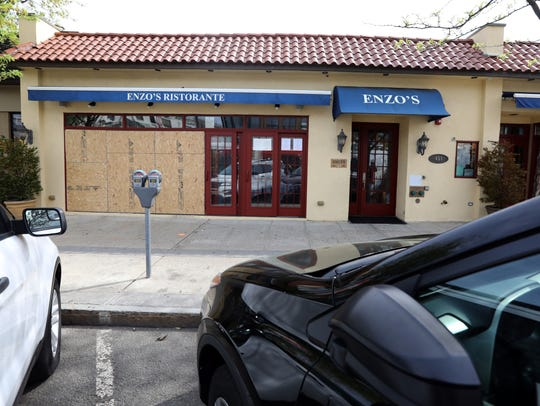 Boarded up windows at Enzo's Restaurant in Mamaroneck