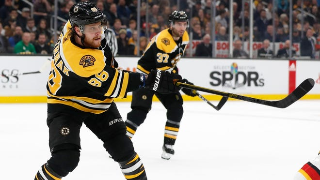 Linemates David Pastrnak, left, and Patrice Bergeron are set to get back in action as the Bruins open round-robin play Sunday afternoon against the Philadelphia Flyers,in Toronto.