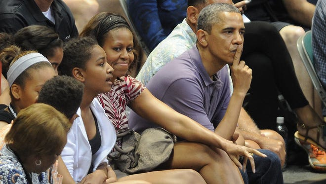 The first family at a college basketball game in Honolulu over winter break.