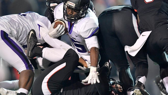 Cane Ridge's Devon Starling (5) dives into Maryville's Matthew Walker (76) during the first half of the Class 6A state championship game at Tucker Stadium in Cookeville, Tenn., Friday, Dec. 1, 2017.