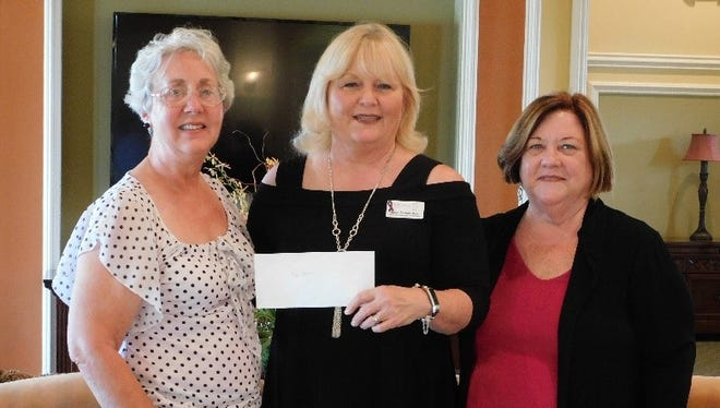 Safe Space representative Janet Farnan-Dyer recently received a check from Inger Marie Ames of Port St. Lucie Art League and Cathy Prisco of St. Andrews Park Villas.
