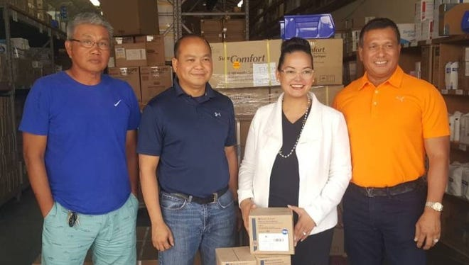 Guam Friendship Golf Club donates $2,500 worth of medicine and supplies to Todu Guam Foundation's mobile medical outreach program. Pictured from left: Windel Bolus vice president of GFGC, Terry Cuabo board member Todu-Guam, Lena Calvo Rodriguez board member Todu Guam and Carlito Pamintuian president of GFGC.