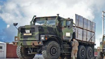Marines from the 31st Marine Expeditionary Unit prepare humvees and seven-ton trucks to move supplies to community centers in affected areas of Saipan during disaster relief efforts
