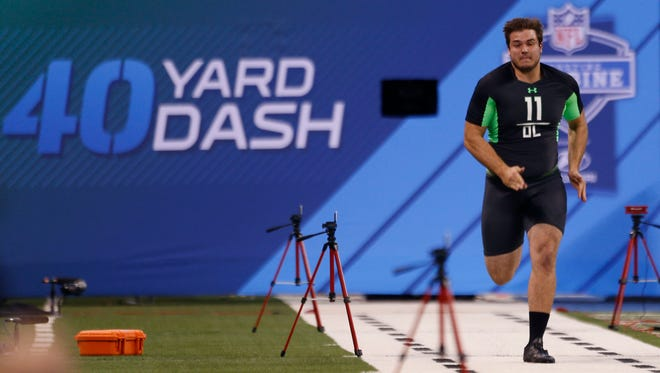 Michigan State offensive lineman Jack Conklin runs the 40-yard dash during the 2016 NFL scouting combine at Lucas Oil Stadium.