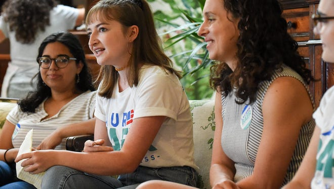 """Rachel Maunus, 18, (center left) of Palm City discusses her reasons for getting involved in politics Saturday, June 23, 2018, while introducing congressional candidate Lauren Baer (center right) during a """"Students for Lauren"""" meeting at Ground Floor Farm in Stuart. The event gave local teens and young adults the opportunity to meet Baer, ask her questions, and to learn about how they can get involved in volunteering for her campaign. To see more photos, go to TCPalm.com."""