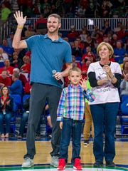 Chris Sale with son Rylan and Laces of Love founder Jeanne Nealon during a recent drive for the Southwest Florida charity at halftime of an FGCU basketball game.