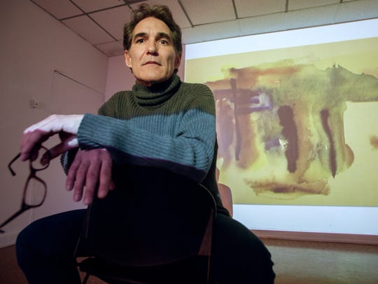 """Peter Stebbins discusses memories of his partner David Jamieson in front of a projection of Jamieson's work titled """"April Colors."""""""