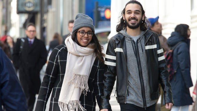 In this Tuesday, March 1, 2016, photo, Nicole DePinto, left, and her husband, Anthony, pose for a photo, in New York. DePinto raised $2,900 on crowdfunding site GoFundMe for an Icelandic honeymoon for the couple. Websites such as Honeyfund, GoFundMe and Honeymoon Wishes make it easy to raise cash for a post-wedding getaway. (AP Photo/Mary Altaffer)