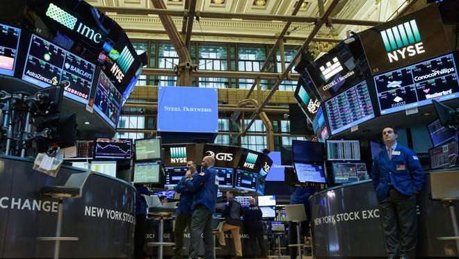 Traders work on the floor of the New York Stock Exchange on March 27, 2017.   (Photo by Drew Angerer/Getty Images)