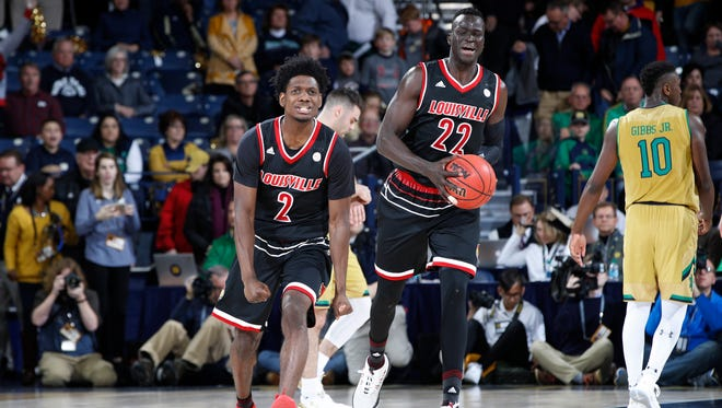 SOUTH BEND, IN - JANUARY 16: Deng Adel #22 and Darius Perry #2 of the Louisville Cardinals react as time expires in a game against the Notre Dame Fighting Irish at Purcell Pavilion on January 16, 2018 in South Bend, Indiana. Louisville won 82-78 in double overtime. (Photo by Joe Robbins/Getty Images)